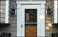 Traditional shake siding with decorative front door surround flutted molding in Randolph, NJ